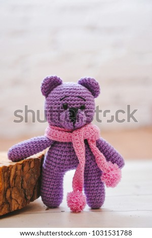 Teddybear toy knitted in the technique of knitting amigurumi