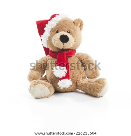 Teddybear with christmas hat and scarf over white background - stock photo