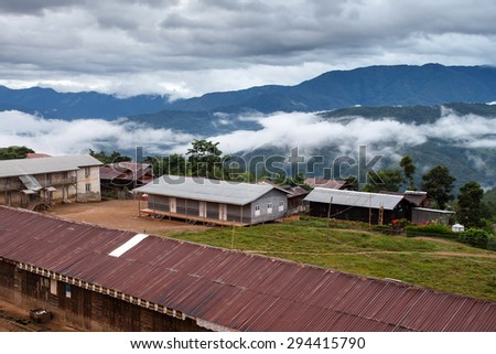 TEDIM, MYANMAR - JUNE 17 2015: Street life going on in the hill village of Tedim in recently opened to tourists Chin State, Myanmar (Burma). - stock photo