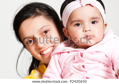 teen age girl with her little sister - stock photo