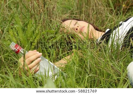 Teen alcohol addiction (drunk teens with vodka bottle) - stock photo