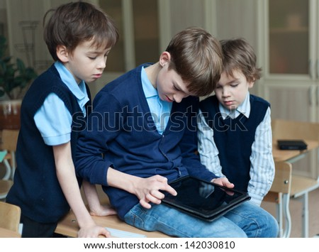 teen and tablet in classroom - stock photo