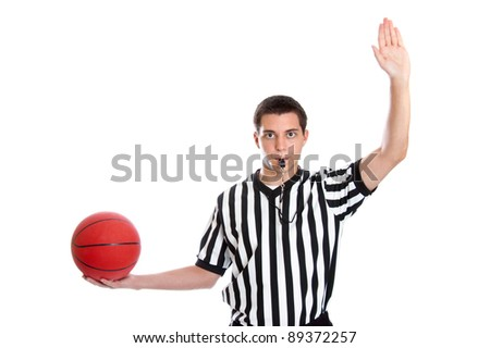 Teen basketball referee giving sign for inbound pass - stock photo