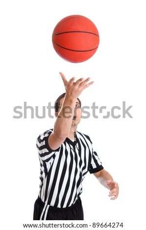 Teen basketball referee throwing ball in the air isolated on white - stock photo