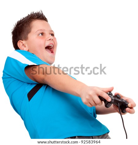 Teen boy having fun  playing with video console. Isolated on white. - stock photo