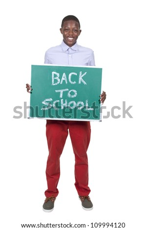 Teen Boy holding a chalkboard that says back to school - stock photo
