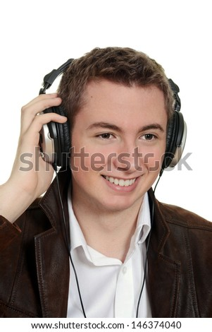 teen boy listening to music with headphones - stock photo