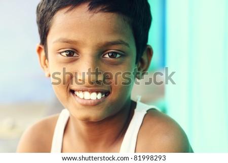 Teen boy looking at the camera. - stock photo