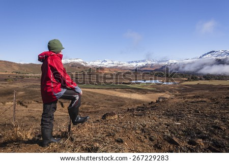 Teen Boy Mountains Snow Valley Landscape Teen boy overlooks mountains snow valley green black contrasted scenic landscape