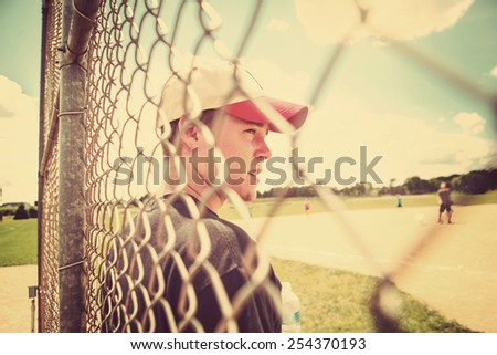 Teen boy on sidelines at baseball practice. Instagram effect.