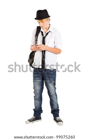 teen boy play with cell phone isolated on white - stock photo
