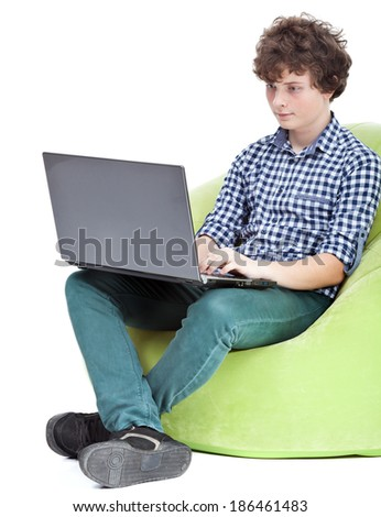 Teen boy playing on notebook