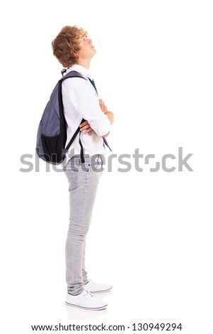 teen boy with backpack looking up - stock photo