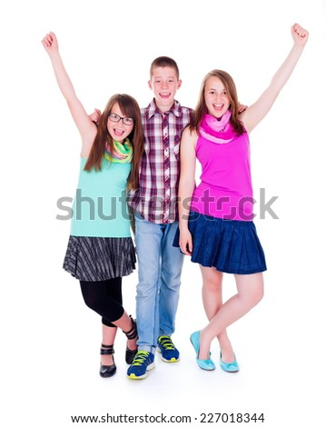 Teen boy with happy girls raising their hands - stock photo