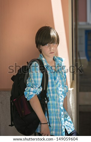 teen boy with rucksack on travel. - stock photo