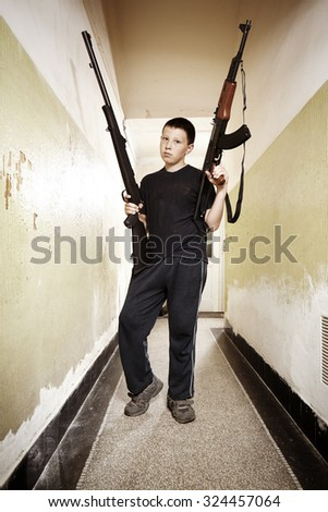 Teen boy with two guns - stock photo