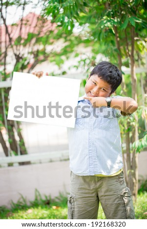 teen boys and girls, showing blank placard board to write it on your own text - stock photo