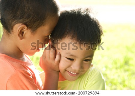 Teen boys gossip, kids telling secrets, ,best friends concept - stock photo