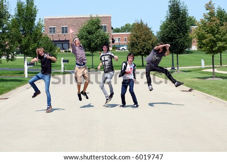 teen boys leaping in a residential setting