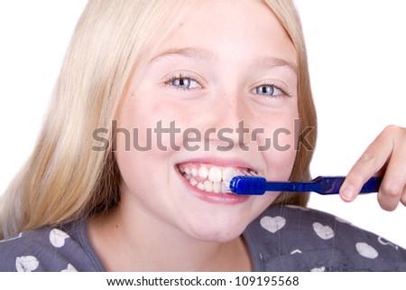 Teen brushing teeth, close up isolated on white - stock photo