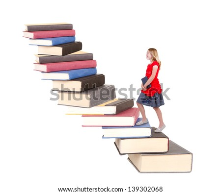 teen climbing a staircase of books, isolated on white