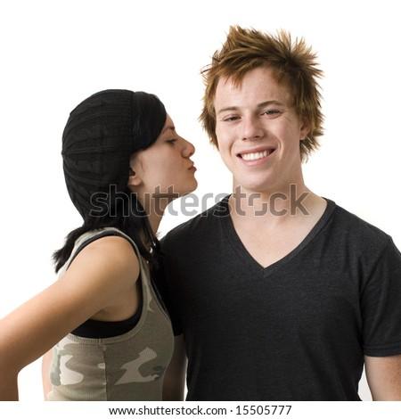 Teen couple against white background - stock photo