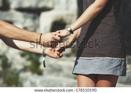 Teen couple bonding, posing together, having fun. - stock photo