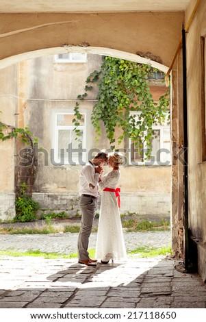 Teen couple embracing on the street - stock photo