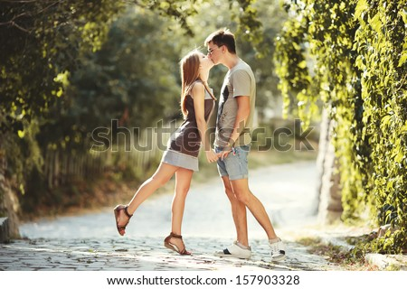 Teen couple kissing at street. Summertime of our love. - stock photo