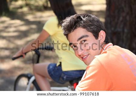 Teen couple on bike ride - stock photo