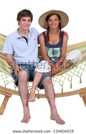Teen Couple on hammock - stock photo