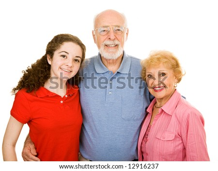 Teen girl and her senior grandparents.  Isolated on white. - stock photo