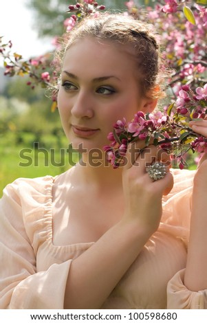 teen girl beautiful cheerful enjoying over spring Japanese cherry tree background - stock photo