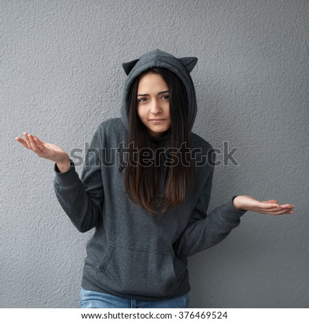 Teen girl does not know the answer - stock photo