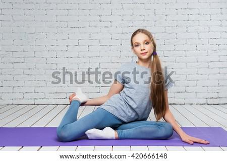 Teen girl doing fitness exercises - stock photo
