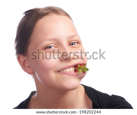 teen girl eating strawberry, studioshot - stock photo