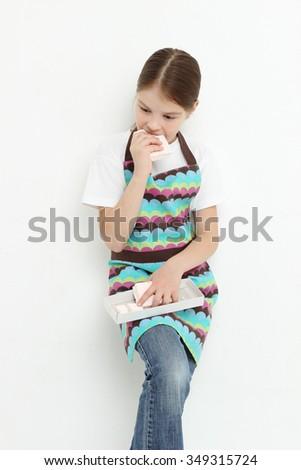 Teen girl eating sweet paste - stock photo