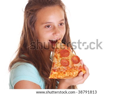 teen girl eats pizza isolated on white