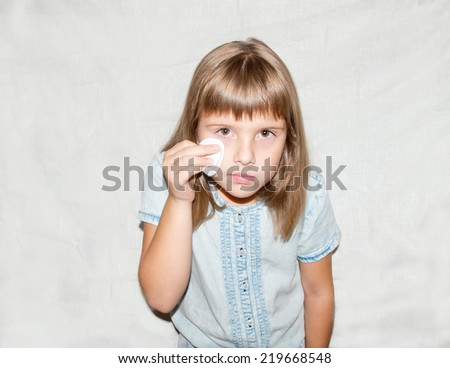 teen girl examines her face - stock photo