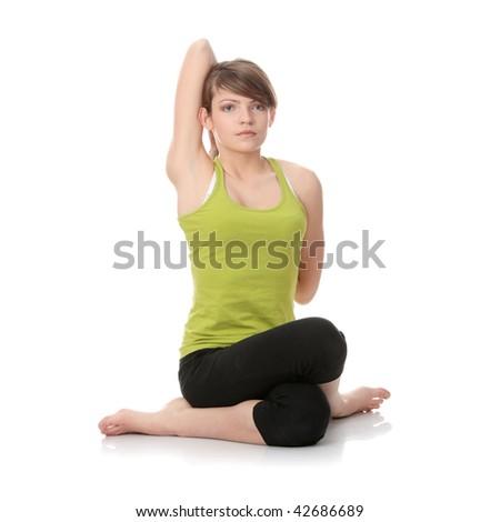 Teen girl exercising isolated on white background - stock photo