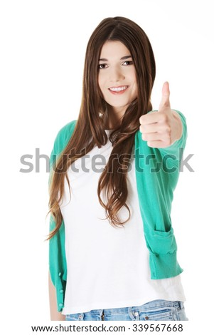 Teen girl gesturing thumbs up. - stock photo