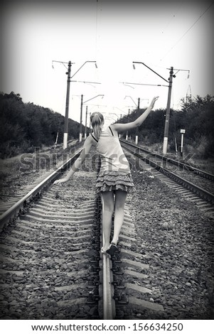 Teen girl goes on rails - stock photo