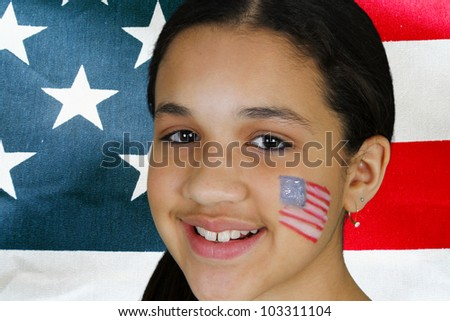 Teen girl has a flag painted on her face