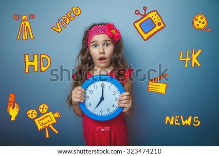teen girl holding a clock on the background of emotion surprise infographics TV channels skeytchi icons in the background - stock photo