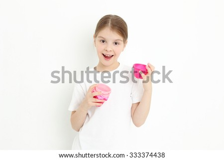 Teen girl holding molds for baking cookies