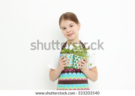 Teen girl holding parsley and green basil