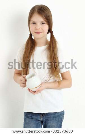 Teen girl holding tea cup - stock photo