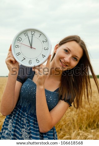 Teen girl holds watches staying outdoors - stock photo