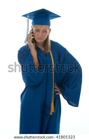 Teen girl in a blue graduation gown talking on her cell phone