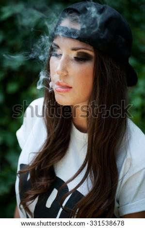 Teen girl in a cap backwards - stock photo